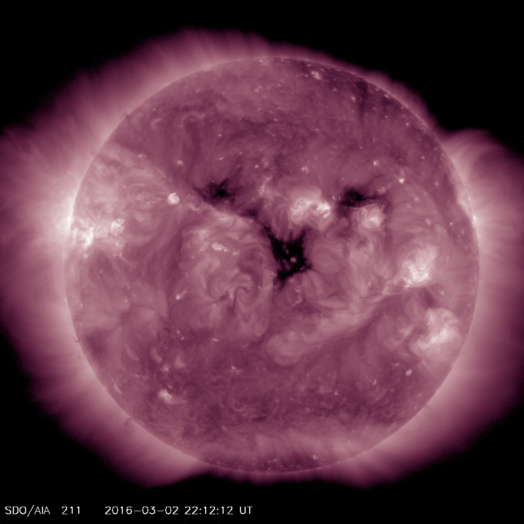 Coronal hole is the dark area shown here in AIA 211 imagery from SDO