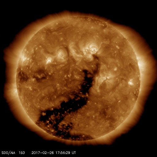 Coronal hole in AIA 193 shown as a dark finger reaching up toward center disk from the pole